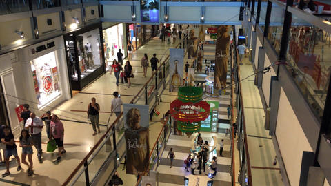 People Christmas shopping at three levels in Buenos Aires shopping mall at high  Footage
