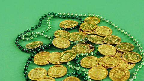 Leprechauns gold and green necklace on green background for st patricks Live Action