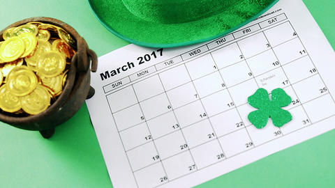 leprechauns hat and pot of gold with calendar for st patricks Live Action