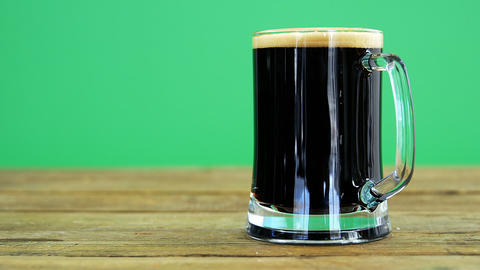 Guinness pint on table for st patrick Live Action