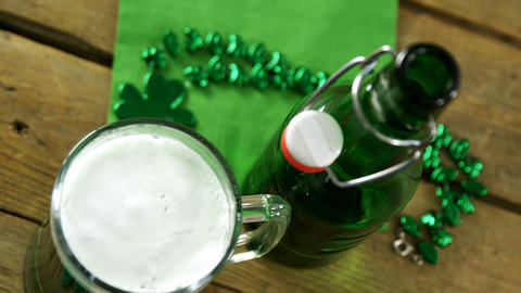 Bird eye view of green beer pint and bottle with green decoration for st Footage