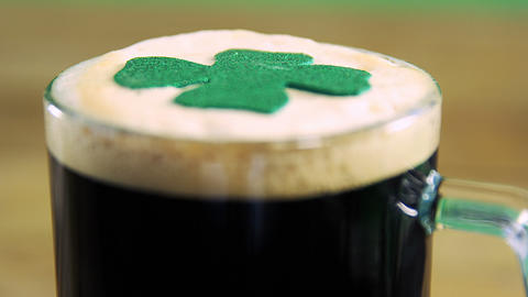 Close up view of head of a pint with shamerock for st patricks day Live Action