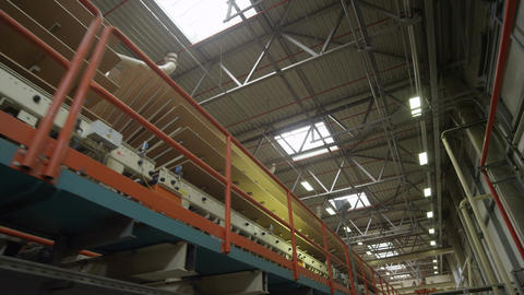 Motion down Chipboard Conveyor in Production Workshop Footage
