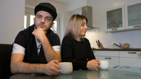 Unhappy upset couple having morning coffee not talking to each other after a fig Footage