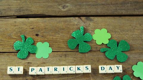 St Patricks day bananagram message with shamrocks on wooden table for st patricks Live Action