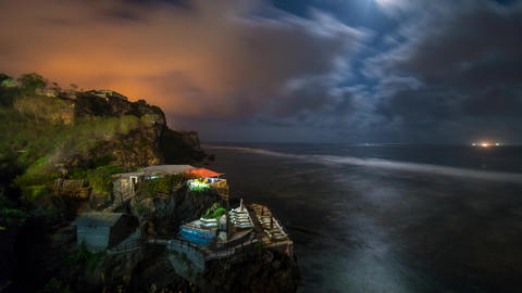Time lapse of clouds and moon over coast of Bali Filmmaterial