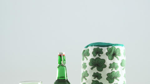 Happy st patricks day message with green pint, bottle and irish hat for st patricks Live Action