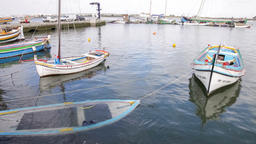boat sunk sunken wood wooden small wreck tied anchored moored pier quay port doc Footage