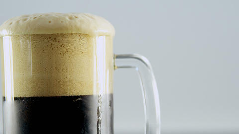Close up view of head of beer pint for st patricks Live Action