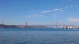lisbon bridge suspension 25 de abril river red painted Tagus rio tejo harbour Footage