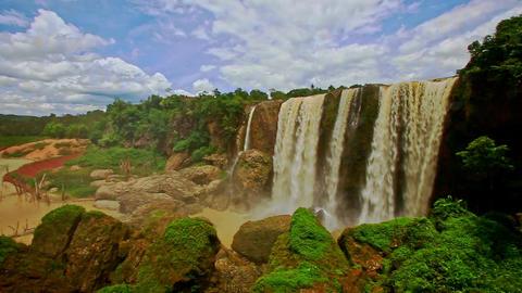 Waterfall Elephant among Tropical Hills with Moss-grown Rocks Footage