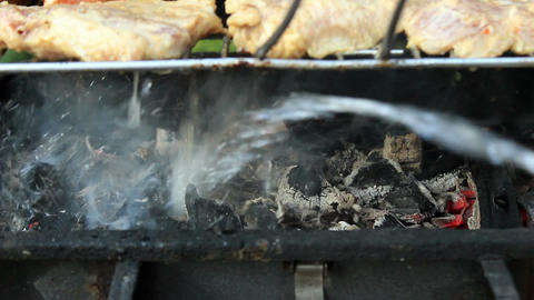 Barbecue in fire and extinguishing a fire with water slow motion Filmmaterial