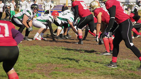 Anxious football players waiting for snap, fierce attack to tackle quarterback Footage