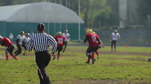 Active players and referee running fast on gridiron, American football match Footage