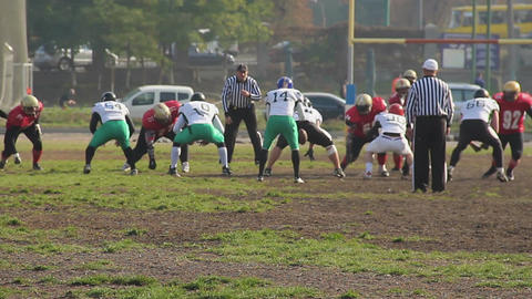 Amateur American football players taking positions before snap, active teamwork Footage