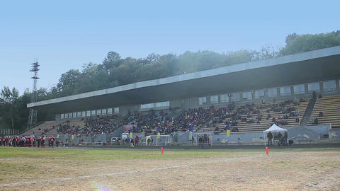 View on old football stadium, fans sitting on tribunes and waiting for the game Footage