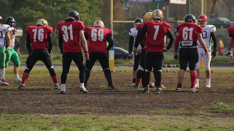 The beginning of American football competition, players preparing for the game Footage