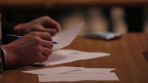 Jury evaluating participants at sports competition, making notes in papers Footage