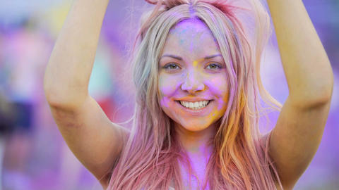 Cheerful young woman smiling to camera, putting sunglasses on, happy person Footage
