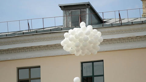 Bunch of white balloons flying in blue sky, traditional ceremony, environment Footage