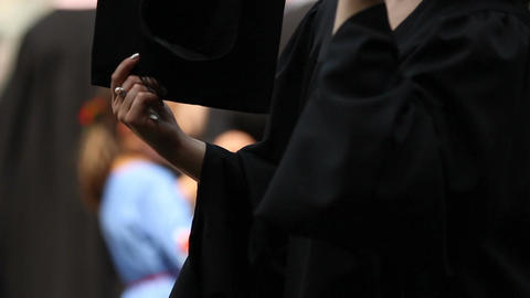 Excited student fanning herself with academic hat, nervous before graduation Footage