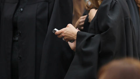 University graduate typing message on smartphone, communication technologies Footage