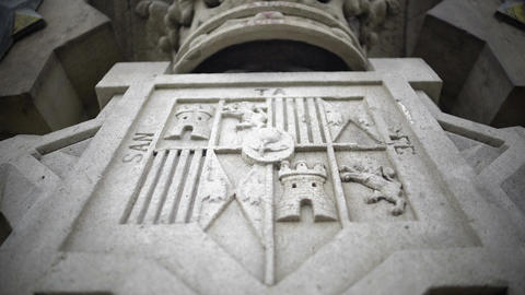 Santa Fe coat-of-arms on Columbus Monument plinth at bottom of tall column Live Action