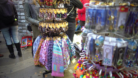 Variety of colorful token gifts at souvenir shop for tourists to remember trip Footage