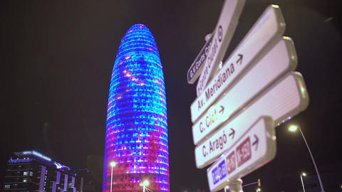 Torre Agbar office building sparkling with many colorful LED lights at night Footage