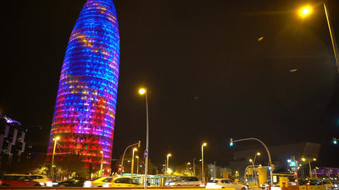 Colorful Torre Agbar skyscraper sparkling at night in Barcelona, Spain landmark Footage
