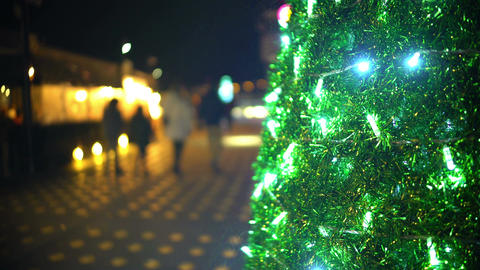 Happy family with children strolling in city, decorated Christmas tree sparkling Footage