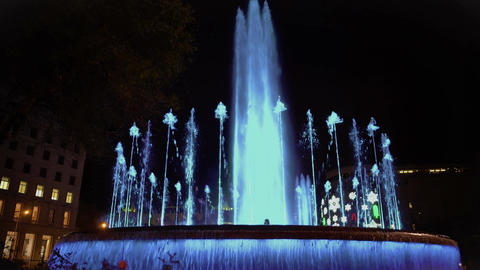 Illuminated dancing fountain, beautiful water and music show, tourist attraction Footage
