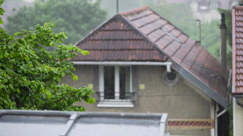 Rainy weather in village, raindrops falling down on house roofs, summertime Footage