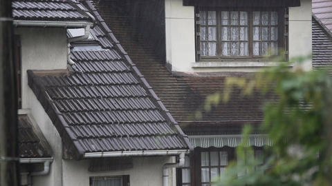 Rain falling on cozy cottages, downpour in old European village, weather Footage