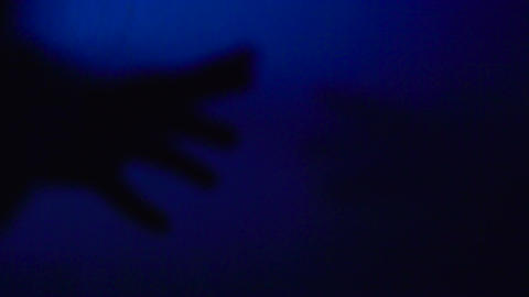 Human hand silhouette contacting aliens, extraterrestrial life. Drug addiction Footage