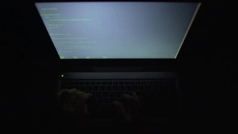 Hacker typing programming code on laptop, access granted, successful data theft Footage