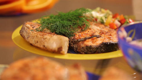 Serve salmon with vegetables Footage