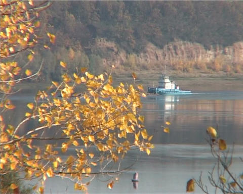 autumn landscape with a view of the river with a tugboat Footage