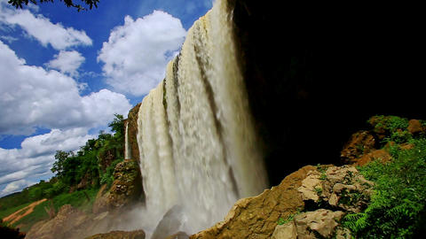 Closeup Powerful Waterfall Flows with Splashes to Rocks Footage