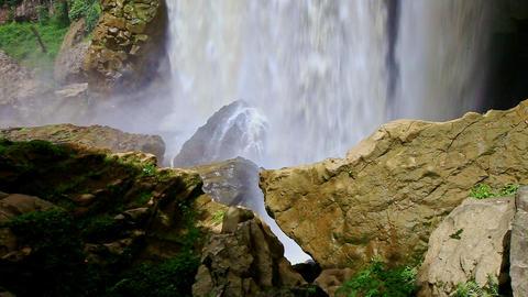 Closeup Powerful Waterfall Bottom with Mist among Rocks Filmmaterial