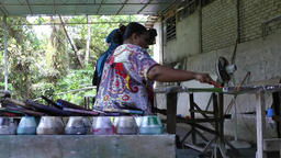 Malaysia Penang island 024 batik manufacture, handwork of native women Footage
