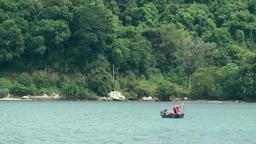 Malaysia Penang island 066 small fishing boat near shore of Pulau Jerejak Footage