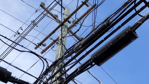 Close up view of a power pole covered in utility cable Footage