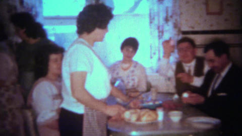 1963: Easter eggs passed around during holiday kitchen dining event. BUFFALO, NE Footage