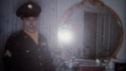 1963: Suave military man turns around from primping in bedroom mirror. BUFFALO,  Footage