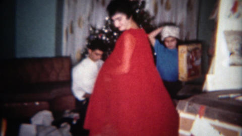 1962: Women showing off red cape dress Christmas holiday outfit. BUFFALO, NEW YO Footage