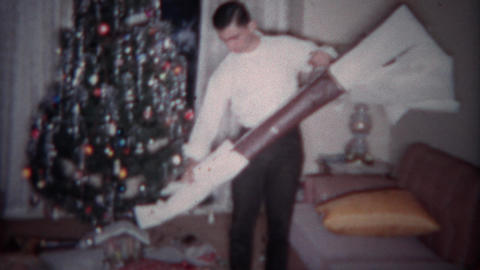 1964: Teenager gets shotgun for Christmas gift. PLANO, TEXAS Footage