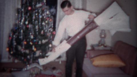 1964: Teenager gets shotgun for Christmas gift. PLANO, TEXAS Footage