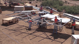 Timelapse video of the assembly of a solar panel array Footage