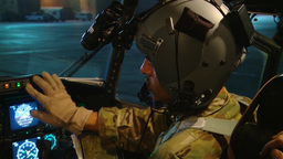 Pilot with night vision goggles ready for C-130H Hercules Airdrop Footage